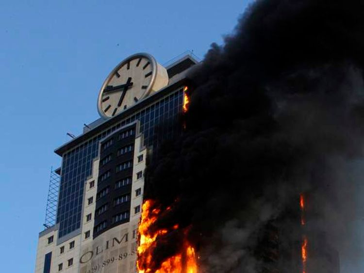 A multi-storey building, which is part of the Grozny-City complex, is seen on fire in the Chechen capital Grozny