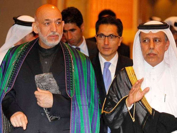 Afghanistan's President Karzai and Qatar's Al Mahmoud attend the U.S.- Islamic World Forum in Doha