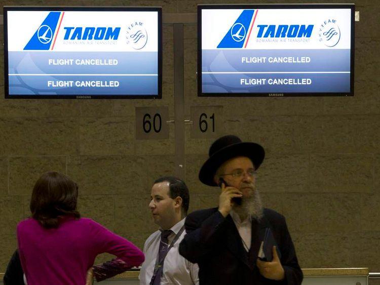 Passengers near a check-in desk at Tel Aviv airport