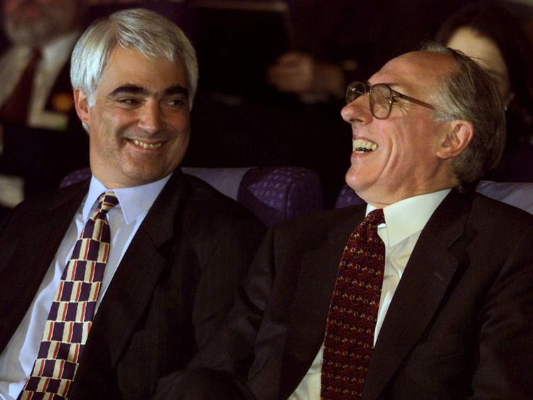 """Scottish Secretary Donald Dewar (R) celebrates after hearing the first declaration in favour of the """"Yes Yes"""" decision from the devolution referendum as Chief Secretary to the Treasury Alistair Darling looks on September 11, 1997"""
