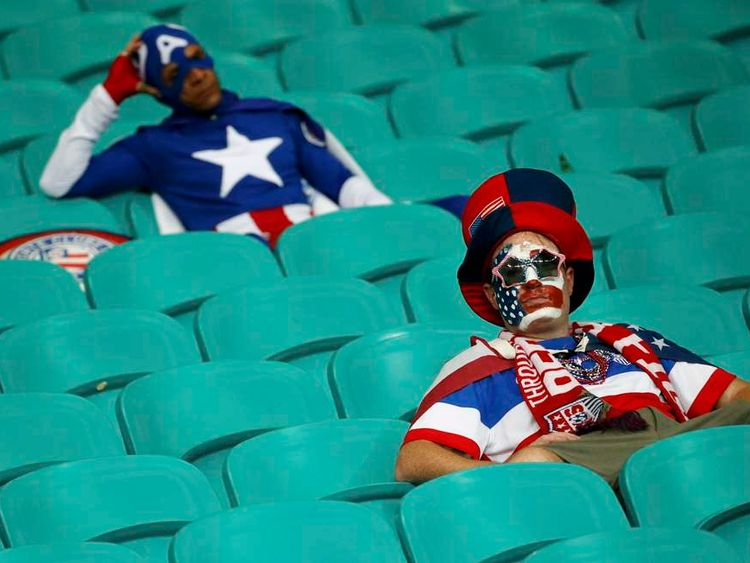 U.S. fans show dejection at the end of the extra time of the 2014 World Cup round of 16 game between U.S. and Belgium at the Fonte Nova arena in Salvador