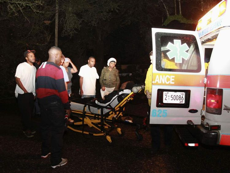 A young man is loaded into an ambulance after being injured during a Christmas Day tornado in Mobile