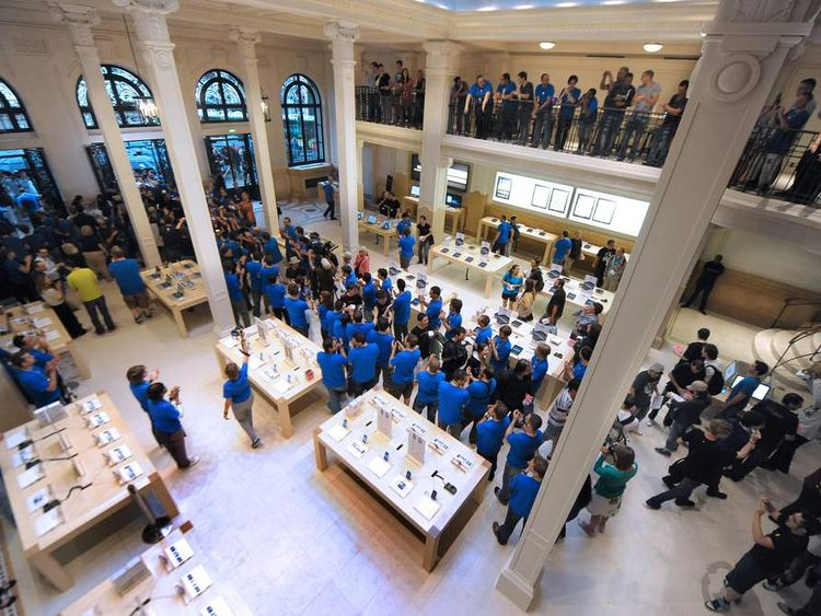 Apple employees greet customers at the store which opened in 2010.