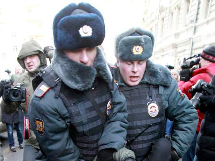 Interior Ministry officers detain a gay rights activist for taking part in an unsanctioned protest near the Duma, Russia's lower house of Parliament, in Moscow