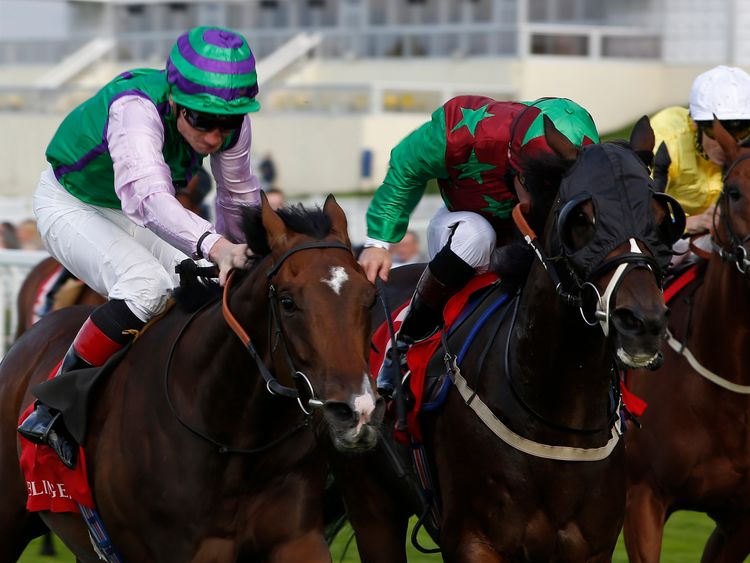 Freddy Tylicki and Arthenus (left) get the better of Robert The Painter to win the Champagne Bollinger Classified Stakes at Ascot in September 2015.