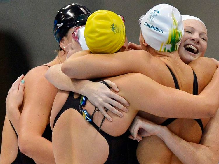 Members of Australia's relay team celebrate winning the women's 4x100m freestyle relay final at the London 2012 Olympic Games