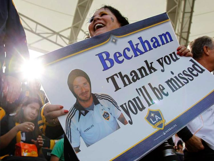 A fan thanks Los Angeles Galaxy's David Beckham with a sign before the MLS Cup championship soccer game against the Houston Dynamo in Carson, California