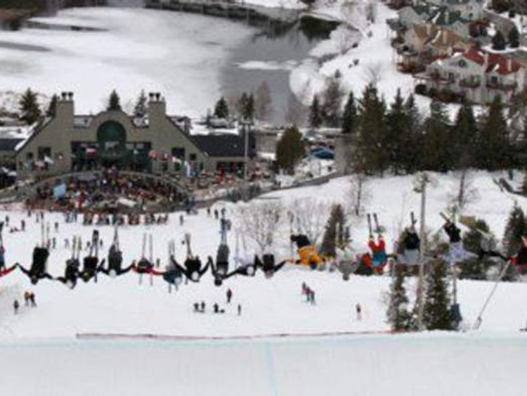 Skiers perform a mass backflip in Quebec
