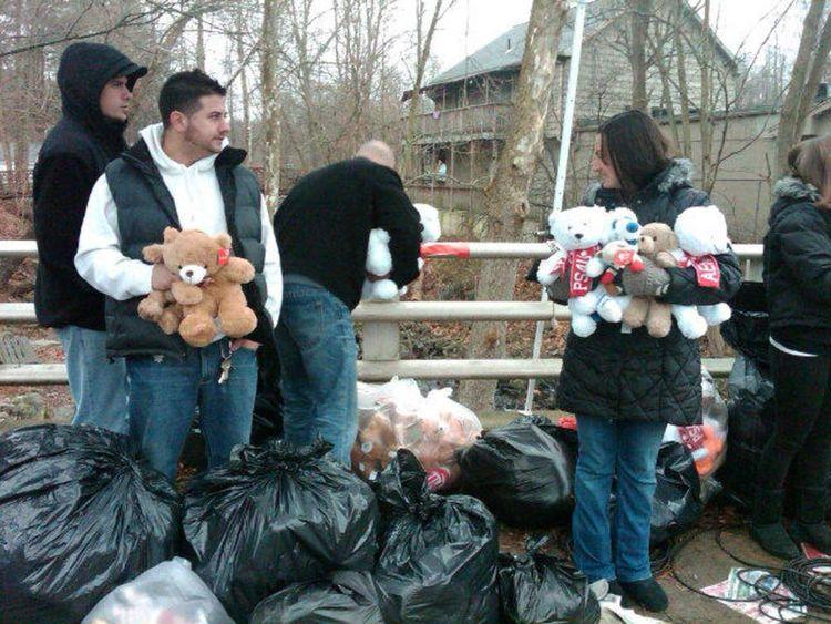 Volunteers hand out teddy bears