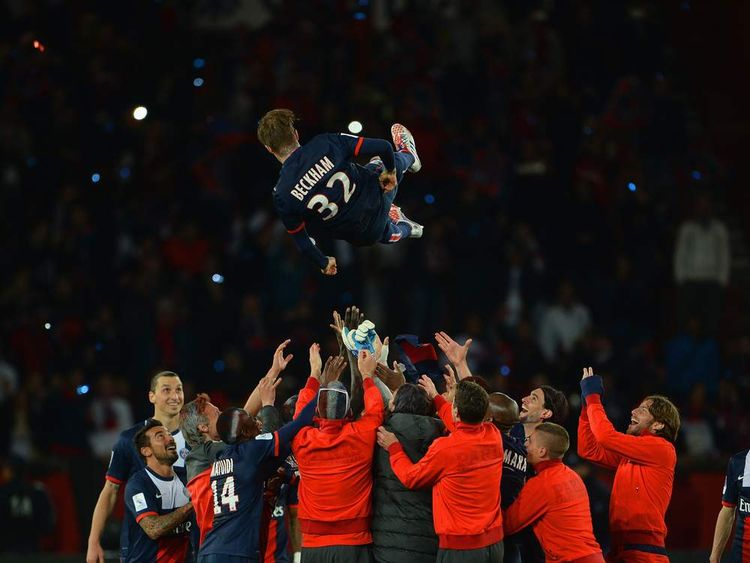 David Beckham thornw in the air by his teammates