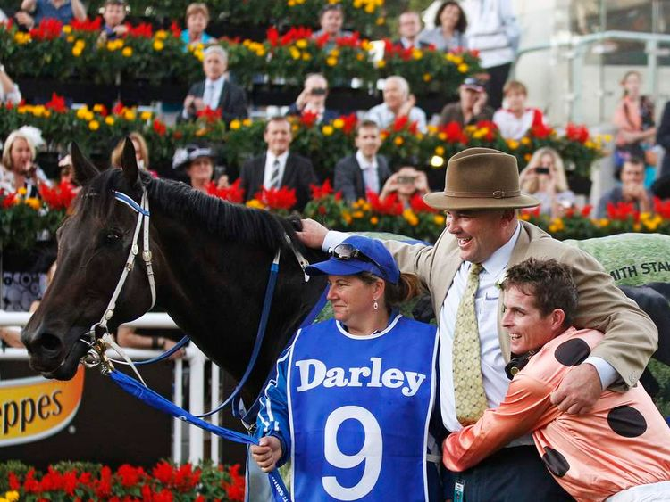 Jockey Nolen embraces Black Caviar trainer Peter Moody after winning the TJ Smith Stakes at Royal Randwick racecourse in Sydney