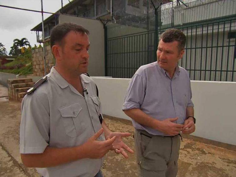 David Bowden (R) talks to Seychelles prison chief