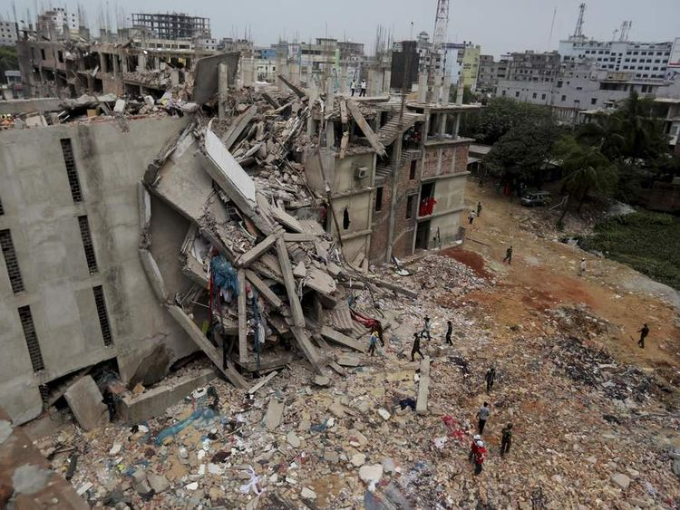 Soldiers and rescue workers at a collapsed building in Savar, near Dhaka