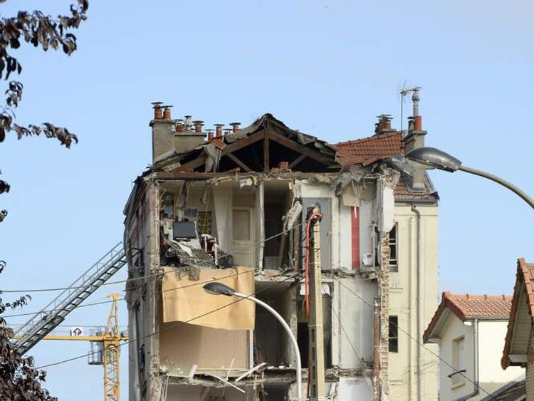 French rescue workers and firefighters search through the rubble of a four-storey residential building that collapsed following a blast in Rosny-sous-Bois in the eastern suburbs of Paris