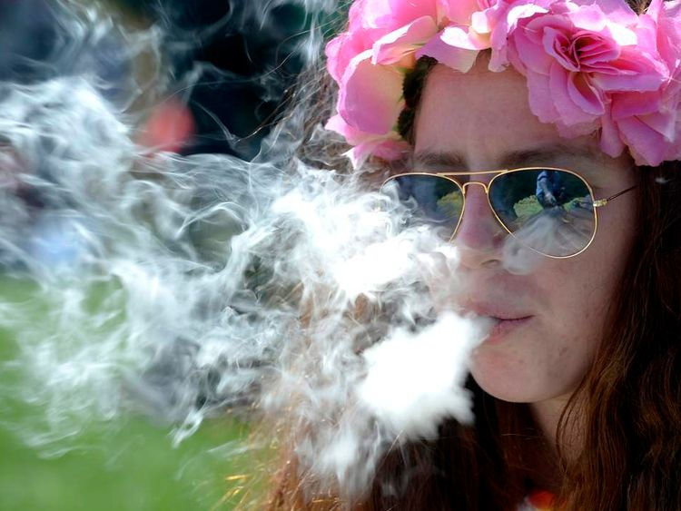 A woman smokes marijuana in Denver, Colorado