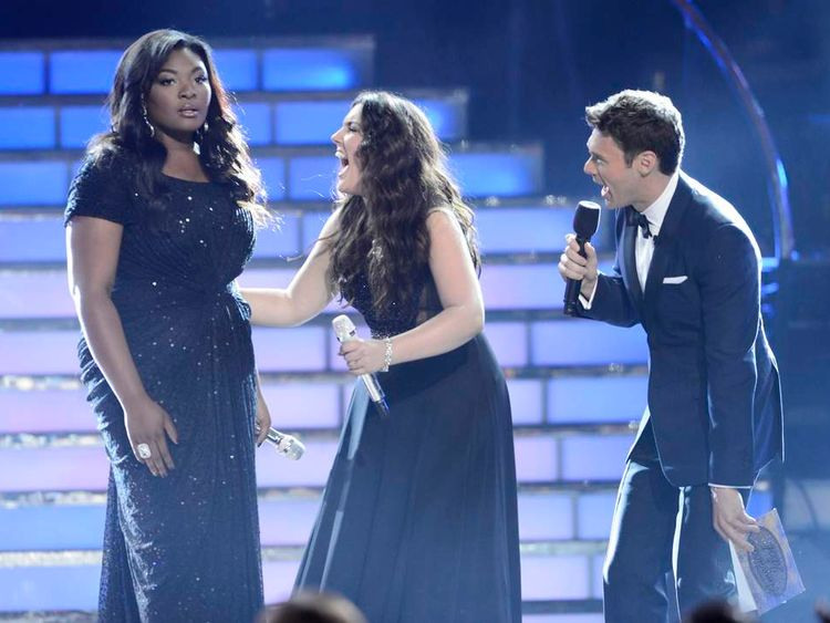 "Finalist Candice Glover is named winner of ""American Idol"" Season 12 by Host Ryan Seacrest as finalist Kree Hamilton reacts during the finale in Los Angeles"