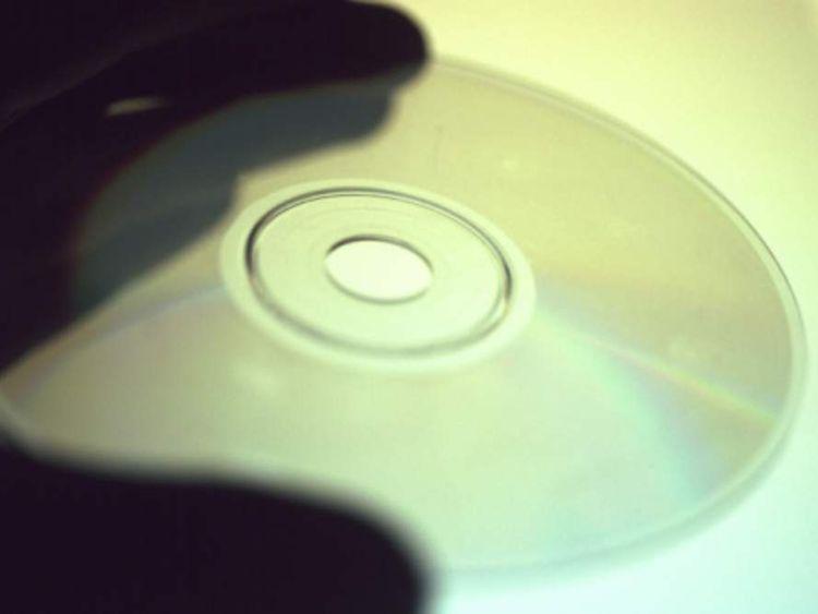 Hand holding CD Rom