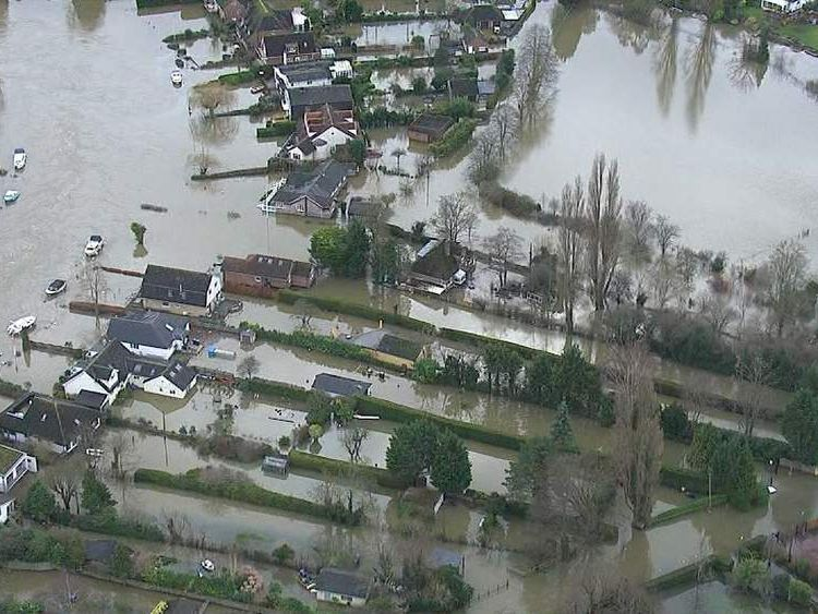 Houses flooded as River Thames bursts banks