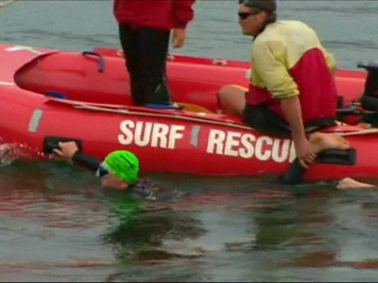 A search team in the waters near the village of Tathra.