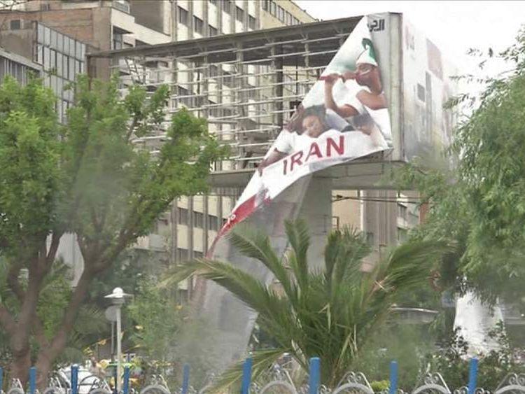 Iran billboard falling down