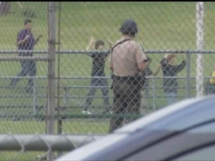 Pupils flee after a gunman opens fire in an Oregon school