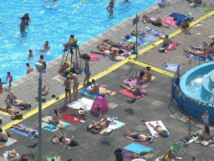 Sun worshippers descend on Tooting Lido
