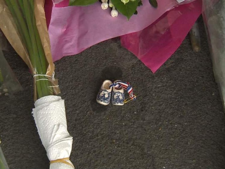 A small pair of clogs left among tributes to the victims of flight MH17.