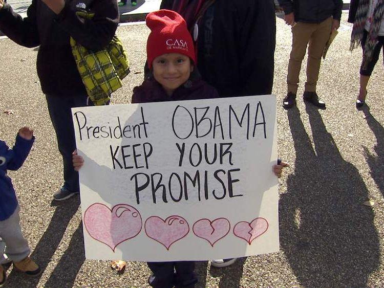 Child holding poster