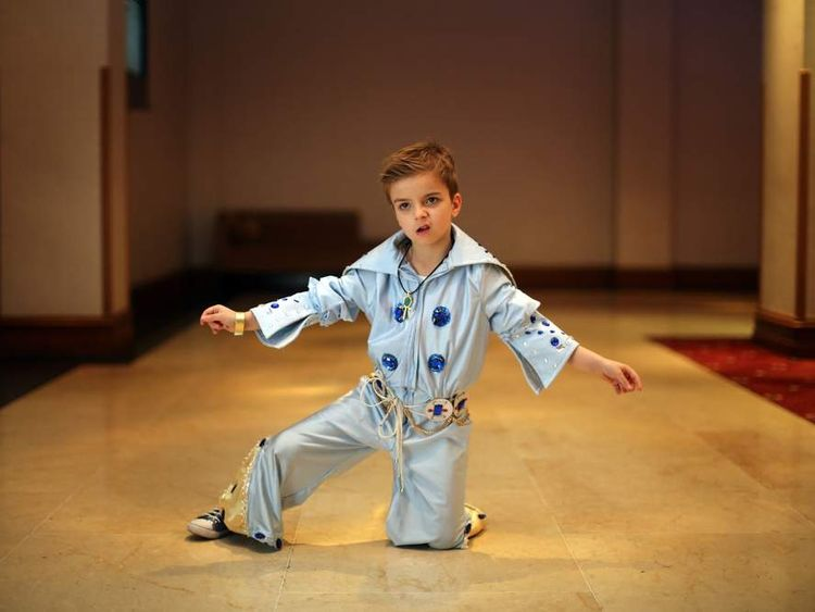 Elvis tribute artist John Paul Mellings, aged 6, poses as he waits to take part in the European Elvis Championships