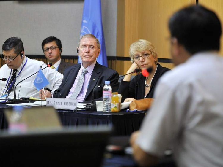 Michael Kirby (C), Chairman of North Korea UN Commission listens to a defector