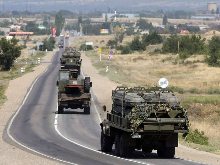 Russian military vehicles loaded with shipping containers for missiles of BUK-M1 air defense missile system