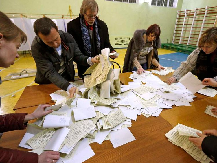 Officials start counting votes of today's referendum in the Crimean capital of Simferopol