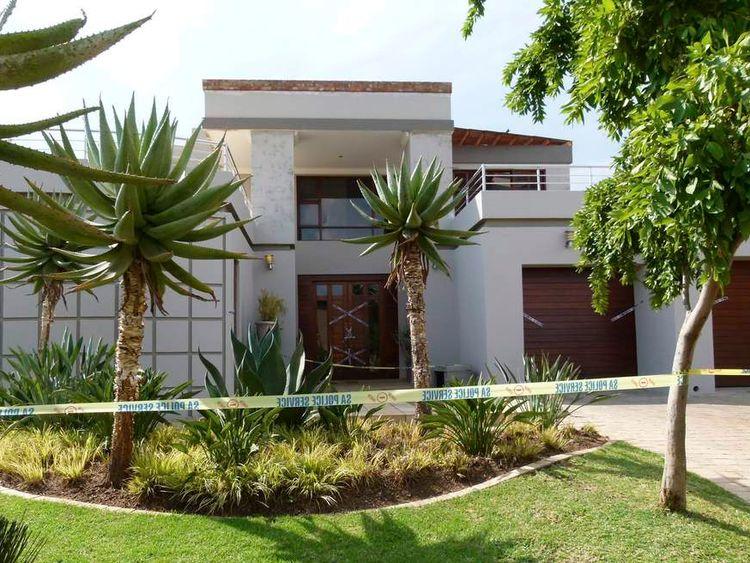 Police crime scene tape marks off the Pretoria home of Oscar Pistorius