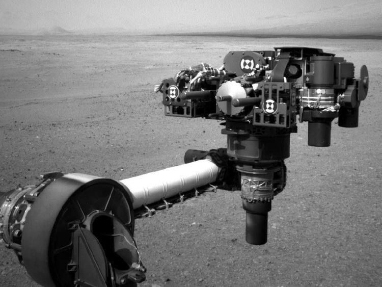 The turret of tools at the end of the Curiosity rover's extended robotic arm