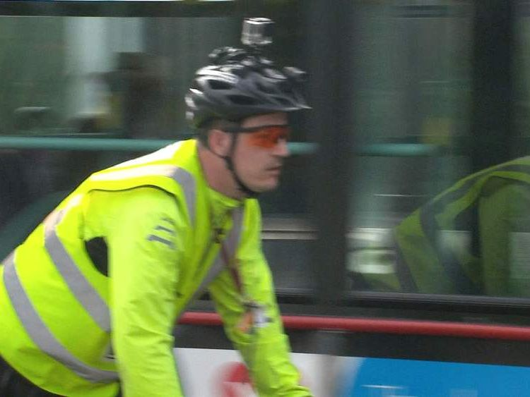 Cyclist wearing a helmet camera