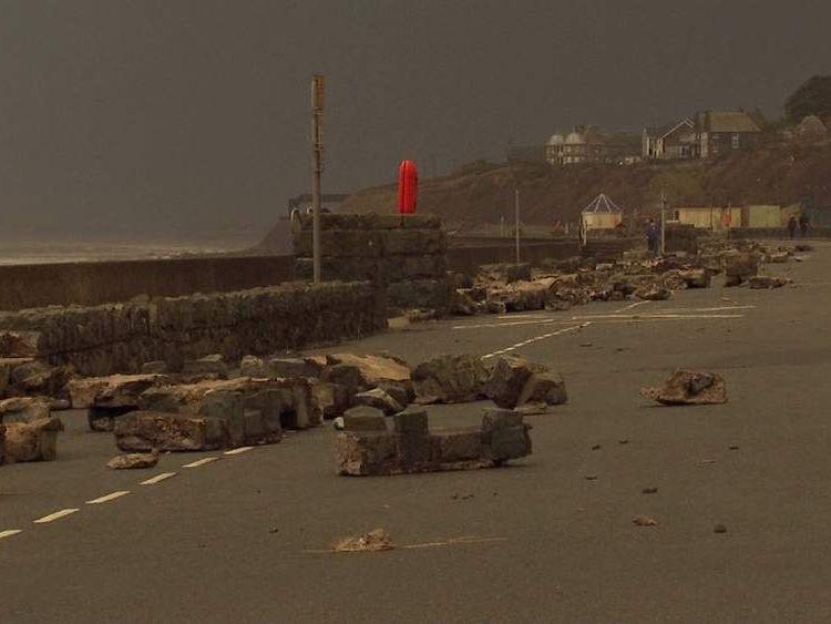 Sea wall damaged wall in Barmouth, Wales