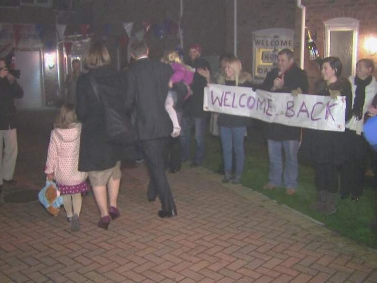 Crowds welcome the family home