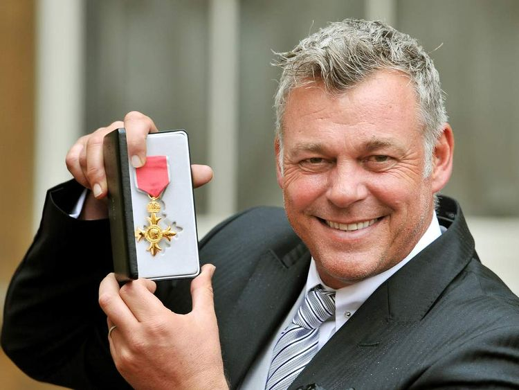 Darren Clarke with his OBE, for services to golf