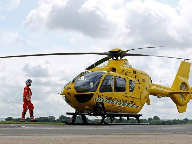 Dr Jayne McKinlay and Dr Antonio Bellini make their way towards the East Anglian Air Ambulance at Cambridge Airport