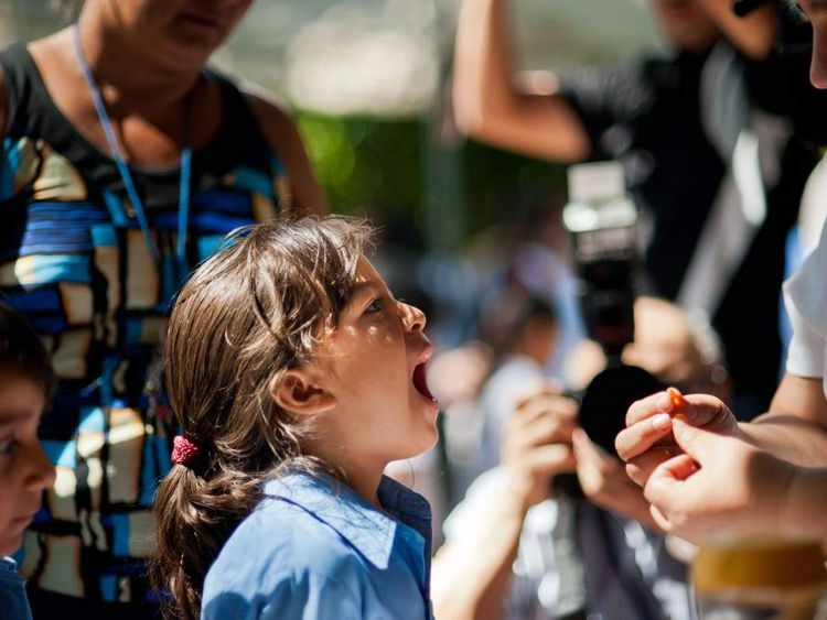 A girl is examined for chikungunya fever in El Salvador, June 2014