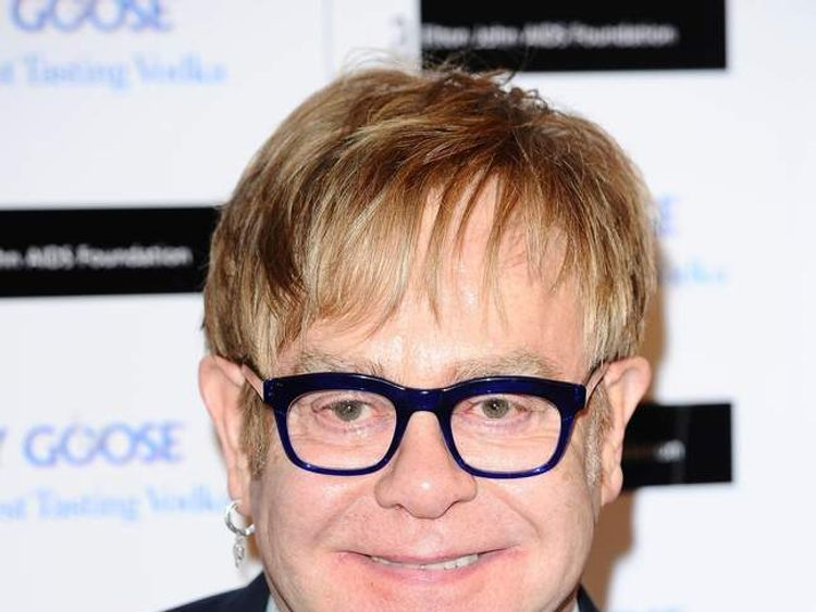 Sir Elton signs deal for Aids book