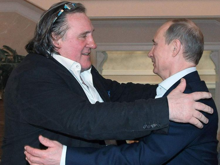 French actor Gerard Depardieu, left, greets Russian President Vladimir Putin