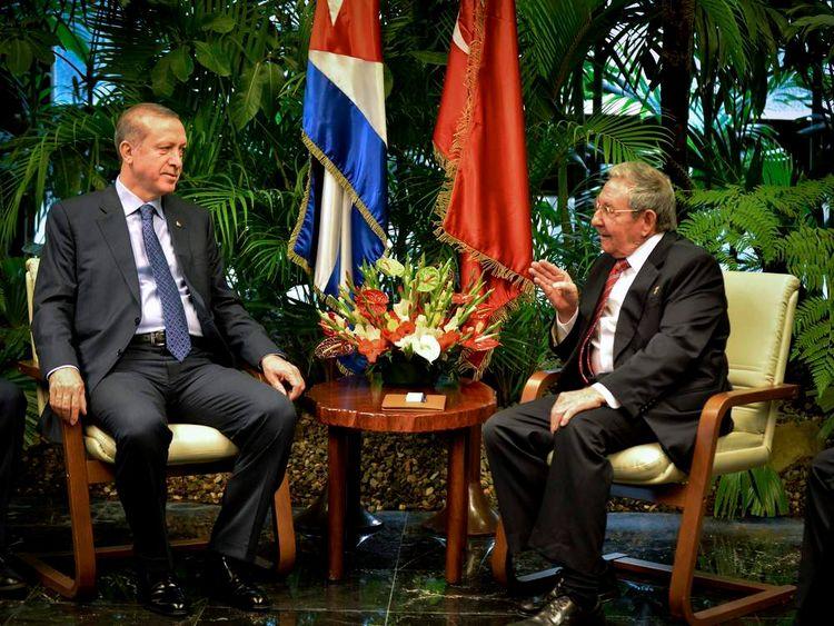 Recep Tayyip Erdogan talks to Raul Castro during a meeting in Havana's Revolution Palace