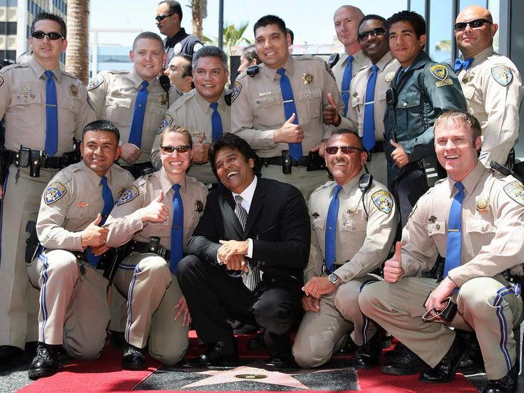 US actor Erik Estrada (C) who played Ponch, the on hit TV series CHiPs