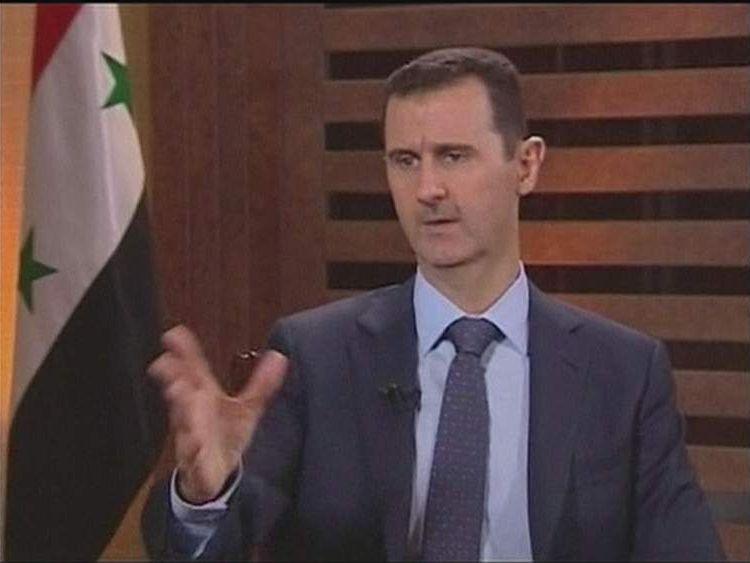 Syria's President Bashar al Assad speaks on Addounia television.