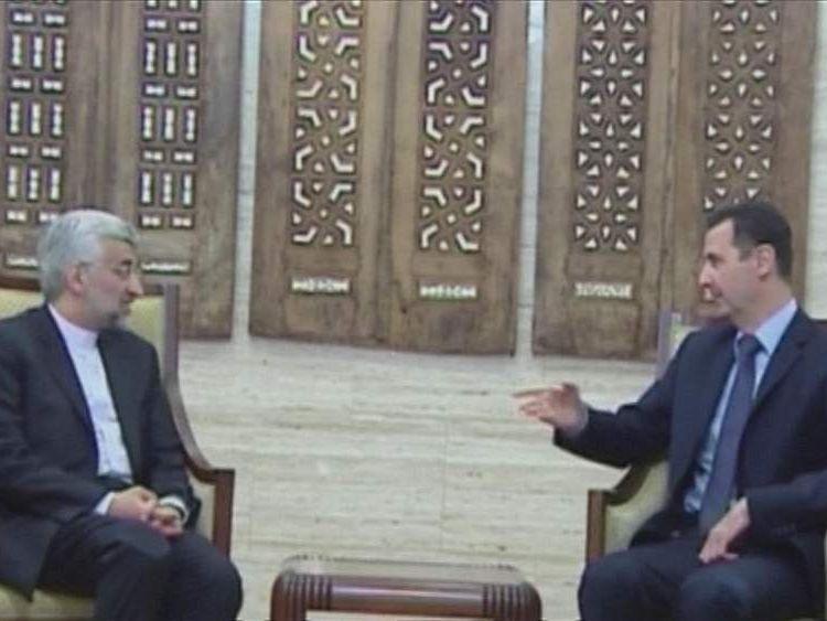 Saeed Jalili and Bashar al Assad