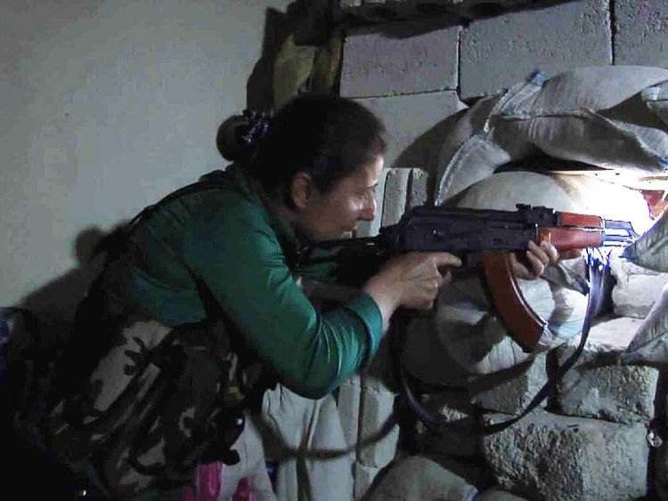 A Kurdish female fighter in Aleppo, Syria