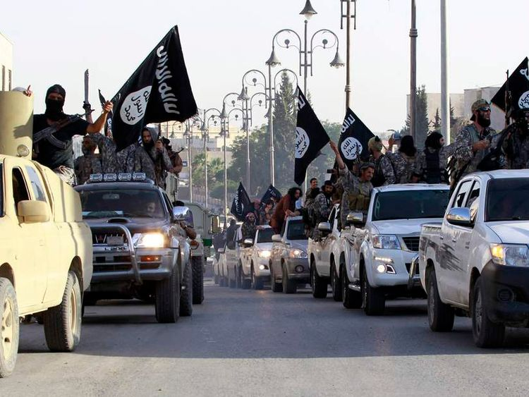 Fighters parade through Raqqa in ISIS-controlled Syria