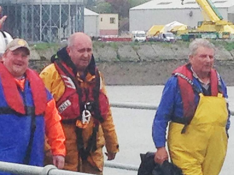 Rescued missing fishermen James Reid (R) and grandson David Irvine (L)