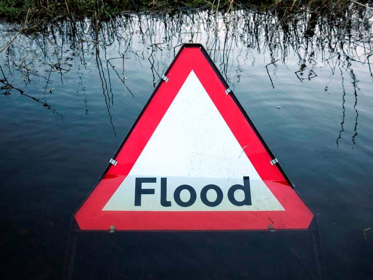A flood sign in the middle of water